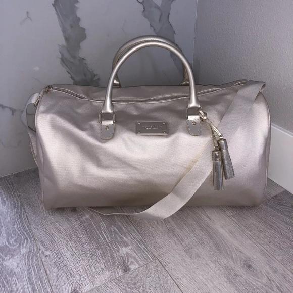 1af832832a NWT MICHAEL Kors Weekend Travel Duffle Bag Gold